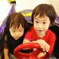 Siblings sharing ride